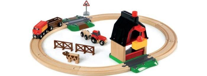 Brio Ж/д с мини-фермой и кормушкойЖ/д с мини-фермой и кормушкойЖ/д Brio с мини-фермой и кормушкой  Замечательный набор из натурального дерева для строительства настоящей железной дороги. С веселыми аксессуарами ребенок создаст свой увлекательный мир. Детская железная дорога имеет много достоинств:  Во-первых, она принесет ребенку настоящую радость. Во-вторых, она прекрасно увлечет малыша, а родители получат свободное время.   Размер: 56x52x18 см<br>