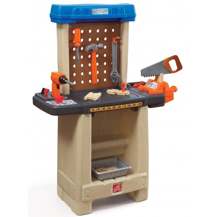 """Step 2 Помощник мастерскаяПомощник мастерскаяРадуга игровая кухня.  Эта компактная мастерская поместится в любой детской комнате. Малыши будут сверлить, пилить, чинить, подражая папе и при этом развивать мелкую моторику рук.   Рабочий стол со встроенным отверстия под болты, дрель и т.д. и реальные рабочие тиски максимизирует творчество ребенка во время игры.  Стенка с крючками, чтобы повесить инструменты  и держать из в чистоте после игры и во время ее.  Внизу место для хранения других аксессуров (гайки, болты, детали)  Включает в себя 4 шт пластиковых деталей под дерево"""", 22 аксессуара для игры.   При сборке следуйте прилагаемой инструкции<br>"""