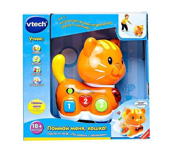 Развивающая игрушка Vtech Поймай меня Кошка 80-122926Поймай меня Кошка 80-122926Развивающая игра Vtech Поймай меня Кошказабавляет малыша игрой в прятки или догонялки: она может как догонять ребенка, так и убегать от него. Перемещается в трех направлениях. Игровой режим сменяет обучающий – кошка расскажет о геометрических фигурах и научит считать.  В процессе игры нос веселой кошки светится, а еще она забавно крутит своим хвостом.  А веселая песенка из мультфильма По дороге с облаками в исполнении кошки обязательно понравится малышу.<br>