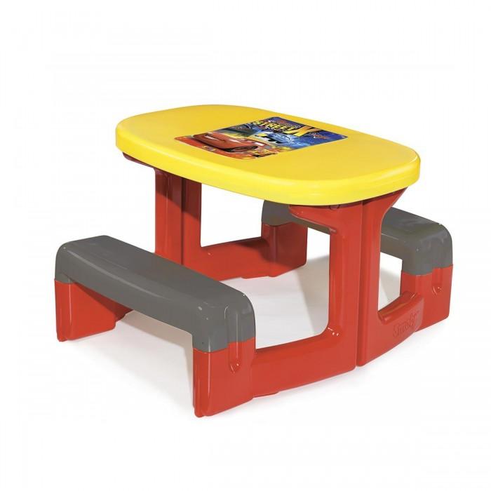 Smoby Столик для пикника CarsСтолик для пикника CarsSmoby Столик для пикника Cars выполнен в стиле одноименного мультфильма.  Особенности: Ребенок может заниматься творчеством за таким красочным столиком, играть в шашки, шахматы, лото с друзьями, или кушать на природе.  Столик легко переносится, поэтому его можно использовать и в доме, и во дворе.  Все детали столика разбираются. Инструкция по сбору игрушки прилагается в комплекте.  В центральной части имеется отверстие для пляжного зонтика (не прилагается в комплекте). Из-за  пластика высокого качества модель устойчива как к морозам, так и к солнечному свету.  Все углы у изделия округлой формы, поэтому минимизирован риск получения травм.  Размер стола: 74 x 80 x 47 см<br>