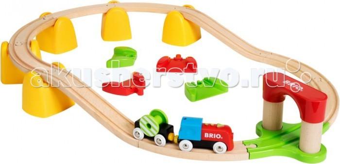 Brio Игровой набор Моя первая железная дорогаИгровой набор Моя первая железная дорогаИгровой набор Мая первая железная дорого от бренда Brio включает в себя деревянные элементы, которые помогут собрать паровозик, рельсы и тоннель. Поезд способен самостоятельно двигаться по рельсам. На последнем вагончике расположен груз в виде катушки, которые крутится при движении паровозика. Вагоны поезда сцепляются с помощью магнитов, поэтому из можно легко разъединить, если это необходимо.  В комплекте:   1 паровоз; 1 вагон; Детали для сборки железной дороги; Аксессуары.  Особенности:   Размер упаковки: 45 х 27 х 12 см Размер площадки: 70 х 48 см<br>