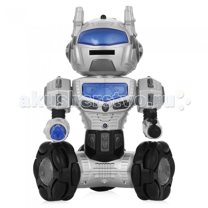 Veld CO Робот радиоуправляемый аккумуляторный Линк 18797Робот радиоуправляемый аккумуляторный Линк 18797Veld CO Робот радиоуправляемый аккумуляторный Линк 18797 может стать верным другом для ребенка. Этот уникальный робот может ходить в любом направлении, вращаться вокруг своей оси и поворачивать голову. А еще он замечательно танцует и умеет разговаривать. Его также можно запрограммировать на 28 определенных команд. Робот реагирует на команды при помощи инфракрасных датчиков, которые также есть в пульте управления. А еще он умеет стрелять специальными дисками, которые также можно найти в комплекте. Робот дополнен световыми эффектами, благодаря которым он выглядит еще фантастичнее. С таким верным союзником ребенок сможет одержать победу в любом межгалактическом сражении и придумать множество увлекательных игровых сюжетов.  В наборе есть несколько пластин из мягкого материала. Их необходимо загрузить в голову робота через открывающийся отсек. Нажимая кнопку на спине, он начнет выплевывать эти пластины поочередно. Робот отвечает на вопросы всего на каждый вопрос можно получить от 1 до 3 ответов, итого - 19 вопросов, 33 ответа.   Игрушка работает от аккумулятора 4,8 V 400 mAh.  В комплекте: робот аксессуары<br>