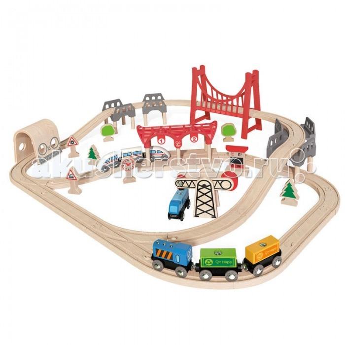 Hape Железная дорога E3712Железная дорога E3712Hape Железная дорога E3712 - мечта любого мальчишки!   Особенности: В игровой набор входит все необходимое для создания реальной картины из жизни в миниатюре и отлично поиграть одному или в компании друзей: рельсы, мостики, депо, 2 состава (грузовой и пассажирский), деревья, часы, железнодорожные знаки и даже погрузчик.  Вагоны крепятся друг к другу магнитными элементами, расположенными в передней и задней частях, что позволяет беспрепятственно отсоединять их, комбинировать по ходу игры.  Кол-во деталей в наборе: 64 шт.<br>