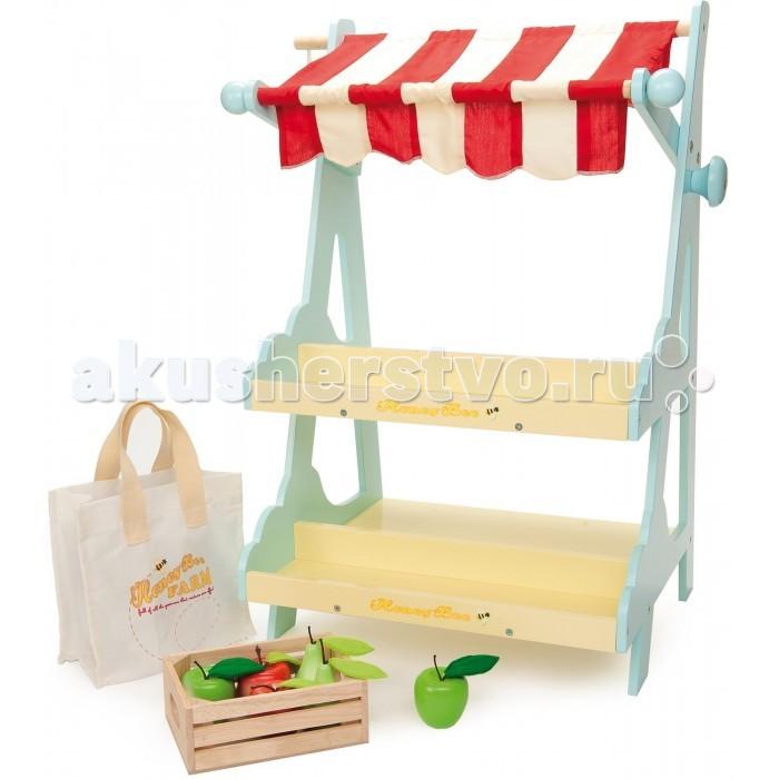LeToyVan Игровой набор МагазинИгровой набор МагазинLe Toy Van Игровой набор Магазин - это деревянный игровой набор, изображающий продуктовый магазин с навесом и колоколом. Магазин с очаровательным полосатым навесом и звонким колоколом  станет отличным подарком для юного покупателя и начинающего продавца.  Набор изготовлен из нетоксичных экологически чистых материалов.   В комплекте:  полосаты навес холщовая хозяйственная сумка  деревянный лоток с яблоками и грушами<br>