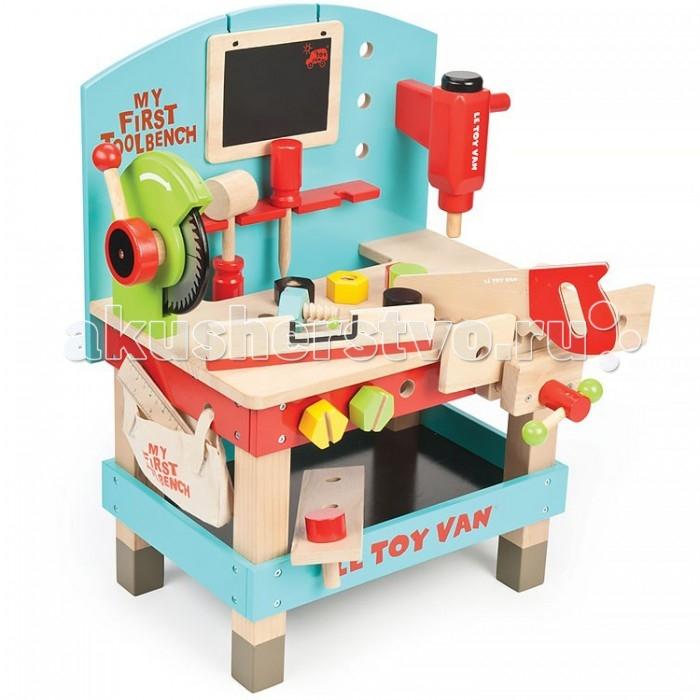 LeToyVan Игровой набор Моя первая мастерскаяИгровой набор Моя первая мастерскаяLe Toy Van Игровой набор Моя первая мастерская станет отличным подарком для юного мастера. Развивает воображение, мелкую моторику, фантазию способствует изучению размеров.Эта замечательная цветная мастерская станет для юного конструктора незаменимым помощником в создании новых творений и воплощении своих фантазий в жизнь. Поверхность столика сконструирована таким образом, чтобы после игры все детали и инструменты можно было компактно сложить на свои места.  В комплект входят:  циркулярная пила  молоток отвертка  гаечный ключ  грифельная доска для заметок удобная подвесная полка  две доски с предварительно просверленными отверстиями<br>