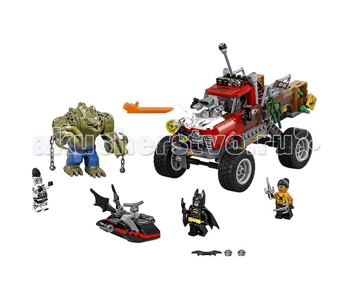 Конструктор Lego Batman Movie 70907 Хвостовоз Убийцы КрокаBatman Movie 70907 Хвостовоз Убийцы КрокаКонструктор Lego Batman Movie 70907 Хвостовоз Убийцы Крока состоит из 460 деталей и 4 минифигурок.  Хвостовоз выполнен в красно-коричневом цвете с бело-серыми деталями. Он украшен различными декоративными элементами: лягушками, водорослями, костью, киркой, решетками, прожектором, выхлопными трубами и подвижным черепом животного на капоте. В комплекте наклейки для обозначения грязи, досок и предупреждающих знаков. Также по бокам расположены ящики с бомбами, которые сбрасываются при повороте деталей в задней части корпуса. У хвостовоза большие колеса и одноместная кабина, так как руль из кабины выходит в кузов, чтобы машиной управлял Убийца Крок.  В водный мотоцикл, черного цвета с красными элементами и 2 крыльями летучей мыши сзади, можно посадить Бэтмана и закрепить сзади бэтаранг. По бокам у него расположено 2 шутера. Минифигрука Бэтмана имеет два выражения лица.  У минифигурки Убийцы Крока огромные когтистые и подвижные руки в наручниках с разорванными цепями, подвижный хвост, поднимающаяся голова и открывающаяся пасть.  В наборе: 460 деталей 4 минифигурки хвостовоз водный мотоцикл наклейки для декорирования<br>