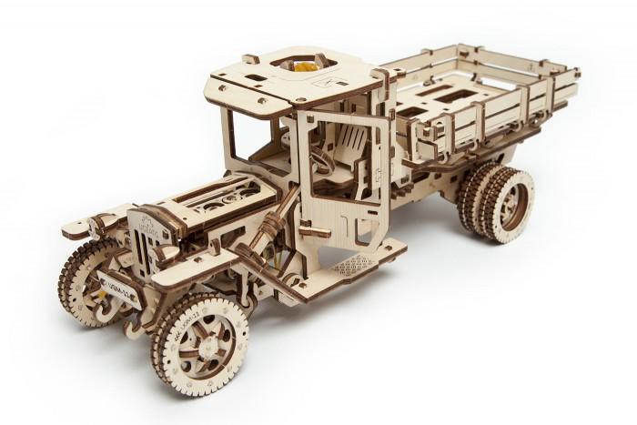 Конструктор Ugears 3D-пазл Грузовик UGM-11 420 деталей3D-пазл Грузовик UGM-11 420 деталейUgears Конструктор 3D-пазл Грузовик UGM-11 420 деталей механический 3D-пазл, модель для самостоятельной сборки без клея и специальных инструментов - готовые детали просто вынимаются из доски.  Приходилось ли Вам когда-нибудь видеть деревянные подшипники или деревянный карданный вал? А может быть Вы встречали работающий деревянный мотор? Грузовик UGM-11 от Ugears - это именно то, что заставит Вас поверить в невозможное!!! От передних фар и до задних колёс, от руля и до кардана, вооруженным глазом и без оптических приспособлений в этом механизме не найти даже маленького намёка на металлические составляющие!   Все, из чего сделан этот великолепный грузовичок - дерево!!! Деревянный номер, деревянная кабина, деревянный кузов, деревянный двигатель, и даже деревянная поршневая система! Мало того! Ведь всё это - живой организм, выполняющий целый ряд механических действий, превращая всю систему в подвижную, динамическую цепь.  Грузовик полностью функционален, может двигаться вперед и назад, перевозить грузы. На одном заводе перемещается на расстояние до 5 метров. Подходит для опытных пользователей.  Особенности Данная модель может ехать с переключением передач, разворачиваться и увеличивать скорость, как и настоящий грузовик В модели реализован четырёхцилиндровый двигатель с приводом от действующей модели карданного вала, который приводится в движение резиномотором при помощи системы шестерней Внутри кабины находится функциональный руль и действующая педаль газа Как и в настоящем прототипе, кузов выполнен с откидными бортами Три режима управления: вперед, назад и холостой ход Способен проехать до 5 метров на 1 заводе Собирается без клея и гвоздей Конструкция модели позволяет наблюдать за работой механизмов Рычаг для переключения режимов расположен сбоку.<br>