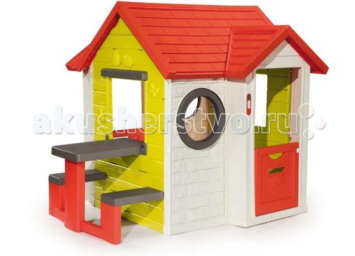 Smoby Игровой детский домик со столомИгровой детский домик со столомSmoby Игровой детский домик со столом, 0.154 х 0.135 х 0.120 см продуман дизайнерами специально для детских игр. Он станет настоящим уютным домиком для малышей от 3 лет. Особенно порадует детей наличие настоящего электронного звонка для гостей и запирающегося на ключик замка входной двери. Ставни на окошках легко открываются и закрываются – поэтому ни на улице, ни в помещении вашему ребенку не будет жарко или холодно. В дверце предусмотрено отверстие для писем.   С задней стороны имеется маленькая дверь. Будучи изготовленным из современного упрочненного пластика ярких цветов, домик легко протирается от пыли влажной тряпкой и не принесет хлопот при использовании. Материал: сверхпрочный пластик, не деформирующийся при сильном морозе и не выгорающий на солнце. Планировка: 2 мансардных окошка, 2 окошка со ставенками и 2 иллюминатора - круглых окна, дверь.<br>