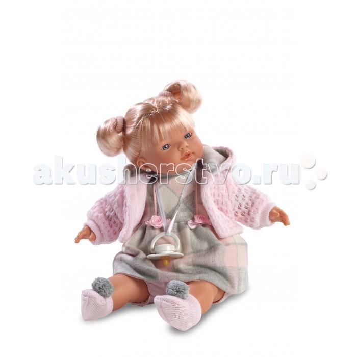 Llorens Кукла Аитана 33 см со звукомКукла Аитана 33 см со звукомLlorens Кукла Аитана 33 см со звуком. Кукла из ПВХ с мягконабивным туловищем из синтетического волокна. Кукла умеет плакать и говорить мама, папа. Кукла одета в серое платье с розовой кофточкой, носочки розового цвета.   К кукле прилагается соска. Если вынуть соску изо рта куклы, то она начинает плакать. Для того чтобы она перестала плакать, поместите соску в рот куклы. Глазки у куклы не закрываются. Волосы прошиты по всей голове. Упакована в подарочную упаковку.<br>