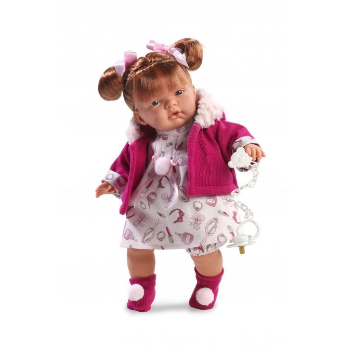 Llorens Кукла Жоэль 38 см со звукомКукла Жоэль 38 см со звукомLlorens Кукла Жоэль 38 см со звуком. Кукла из ПВХ с мягконабивным туловищем с наполнителем из синтетического волокна. Кукла умеет плакать и говорить мама, папа. Одета в белое платье, розовую кофточку, носочки.   К кукле прилагается соска. Если вынуть соску изо рта куклы, то она начинает плакать. Для того чтобы она перестала плакать - поместите соску в рот куклы. Глазки у куклы не закрываются. На личике имеются веснушки. Волосы прошиты по всей голове. Упакована в подарочную упаковку.<br>