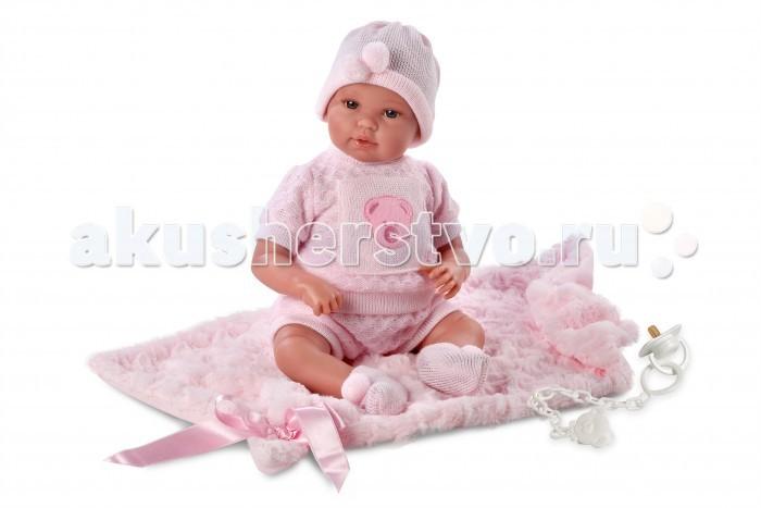 Llorens Кукла младенец 36 см с одеяломКукла младенец 36 см с одеяломLlorens Кукла младенец 36 см с одеялом. Кукла из ПВХ с мягконабивным туловищем из синтетического волокна. Без механизмов и звуковых эффектов. Кукла одета в розовую маечку, штанишки, шапочку, носочки. Глазки у куклы не закрываются. К кукле прилагается соска и одеяло.   Упакована в подарочную упаковку.<br>