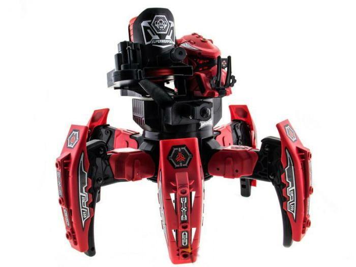 Veld CO Боевой робот Space WarriorБоевой робот Space WarriorVeld-Co Боевой робот Space Warrior на радиоуправлении снабжён пушкой, угол выстрела которой может регулироваться с пульта управления. Также пушка снабжена лазерным прицелом для более точных попаданий.  Пушка заряжается 12 дисками (в комплекте), выстрел которых может поразить цель на расстоянии до 5 метров! Для того, чтобы уничтожить робота соперника необходимо попасть ему в голову трижды: каждый робот снабжён световыми индикаторами, которые показывают его уровень жизни. Как только уровень жизни снизится до нуля – робот автоматически отключится. Попадание по ногам робота противника уничтожает его броню (при попадании по пластинке брони, она отскакивает).  Высокая маневренность роботов, звуковые и световые эффекты сделают битву более зрелищной, а набор боевых наклеек (входят в комплект) позволят сделать робота совершенно индивидуальным!<br>
