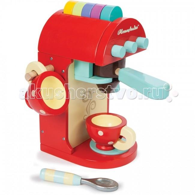 Деревянная игрушка LeToyVan Игровой набор Кофе-машинаИгровой набор Кофе-машинаLeToyVan Игровой набор Кофе-машина.  Игровой набор Кофе-машина, предназначена для детей от 3 лет. Мы предлагаем вашему вниманию новинку от английской компании Le Toy Van. Яркая и функциональная игрушка, выполненную из дерева. Её размер 11 х 21 х 19 см.  Мы все хотим, что бы наши дети легко адаптировались к современному ритму жизни. Этому способствует, в том числе, отработка повседневных навыков через игру. Дети учатся готовить, стирать, ухаживать за домом, делать покупки. А вы можете помочь ребенку в этом и рассказать о безопасности. Наши кухни становятся все более технологичными и кофе-машина прочно заняла свое место в ряду необходимых бытовых приборов.  Кофеварка ярко-красного цвета оснащена съемной коричневой емкостью для кофе с голубой ручкой и 3 кнопками на передней панели. Сверху есть лоток для сменных кассет. В комплект входят 5 кассет разного цвета: желтая, салатовая, сиреневая, синяя, бирюзовая. Сбоку есть поворотная ручка голубого цвета, а с противоположной стороны стержень, на который удобно вешать чашку. Две красные чашки в белый горошек идеально сочетаются с кофеваркой. Есть так же и ложка. Игрушка станет замечательным и практичным подарком для любого ребенка старше 3 лет. Привлекательный дизайн. Приятные на ощупь поверхности.Красивая подарочная упаковка.  Игровой набор Кофе-машина, это: яркая и функциональная кофе-машина, размером 11 х 21 х 19 см 5 сменных кассет разного цвета: желтая, салатовая, сиреневая, малиновая, бирюзовая 2 красные чашки в белый горошек ложка привлекательный дизайн, приятные на ощупь поверхности красивая подарочная упаковка.<br>