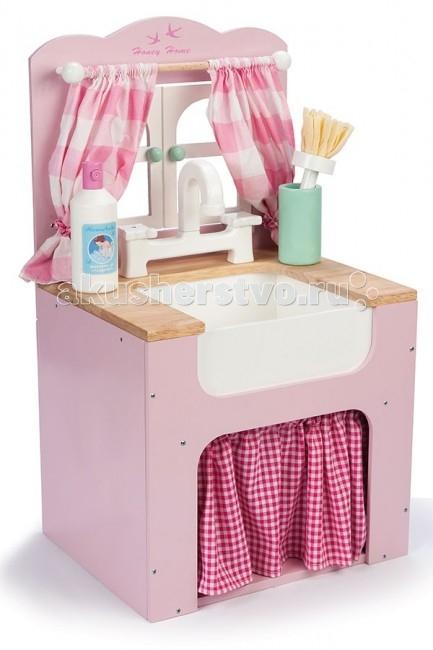 Деревянная игрушка LeToyVan Игровой набор Кухонная мойкаИгровой набор Кухонная мойкаLeToyVan Игровой набор Кухонная мойка.  Игровой набор Кухонная мойка с аксессуарами Le Toy Van для детей от 3 лет. В 2014 году английская компании Le Toy Van расширила линейку детских игрушек на тему кухня, посуда, еда и выпустила новый, очень интересный набор с аксессуарами. Теперь наш интернет-магазни Кукладом может предложить своим маленьким покупателям не только разнообразные игровые наборы с игрушечной посудой, едой и бытовой техникой, но также возможность помыть посуду после званного ужина или обеда.  Кухонная мойка - это неотъемлемый предмет мебели любой кухни. И чем он ярче и привлекательнее, тем интереснее играть. Тумба под мойку выполнена в розовых тонах. Верхняя часть сделана в виде двухстворчатого окна. На карнизе висят очаровательные занавески из ткани. Сама мойка комбинированная: столешница под цвет натурального дерева и белоснежная раковина из натурального камня. Классический смеситель с изогнутым носиком и двумя кранами.  Под мойкой организовано место для хранения посуды и кухонной утвари, которое закрывается в стиле кантри текстильной шторкой на сборке и особенно привлекает классическим рисунком в мелкую красную клеточку. Кстати, дизайнеры постарались даже в детской игрушке учесть все детали и мелочи. Шторки внизу по рисунку и цвету перекликаются с занавесками у окна. А в комплект с мойкой предусмотрительно добавили флакон с моющим средством и зеленый стаканчик с щеткой.Вручите вашему ребенку игровой набор Кухонная мойка с аксессуарами Le Toy Van, возможно, это именно то, о чем он так долго мечтал.  Игровой набор Кухонная мойка: мойка и тумба для хранения окно с занавесками на карнизе столешница и белоснежная раковина классический смеситель с двумя кранами занавески из ткани пузырек с моющим средством и стакан со щеткой размер игрушки 34.4x53.4x29.5 см. красивая подарочная упаковка.<br>