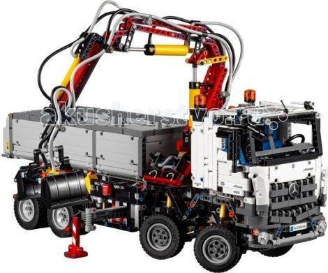 Конструктор Lego Technic Mercedes-Benz Arocs 3246Technic Mercedes-Benz Arocs 3246Конструктор Lego Technic Mercedes-Benz Arocs 3246 - станет лучшим подарком для поклонников серии Technic!   Корпус грузовика выполнен из бело-серо-чёрных деталей с добавлением красных элементов и узнаваемых логотипов Mercedes-Benz. Спереди видна массивная кабина водителя, оборудованная боковыми зеркалами, открывающимися дверями, системой освещения, непробиваемой радиаторной решёткой, двумя синими креслами и приборной панелью. Откинув кабину, можно рассмотреть 6-ти цилиндровый двигатель с жёлтыми подвижными поршнями. Ходовая часть грузовика представлена независимой подвеской с амортизаторами особой прочности. На передней оси установлены четыре рулевых колеса, управлять которыми можно с помощью закреплённых на крыше сигнальных огней. Задняя ось выглядит очень надёжной. Это достигается благодаря спаренным колёсам, повышающим маневренность и грузоподъёмность. Чтобы предотвратить опрокидывание корпуса во время погрузочных работ, необходимо воспользоваться выносными опорами. Выдвигаясь автоматически, они встают поперёк подвески, повышая устойчивость грузовика, стабилизируя его положение на неровном грунте и снижая осевые нагрузки.  Уникальный механизм позволяет автоматически поднимать и опускать кузов, регулировать положение подножек, управлять погрузочным краном, закрывать грейфер. По завершении сборки модель представляет собой миниатюрную копию прототипа. Разработчики воссоздали экстерьер, уделили внимание проработке основных агрегатов и узлов.<br>