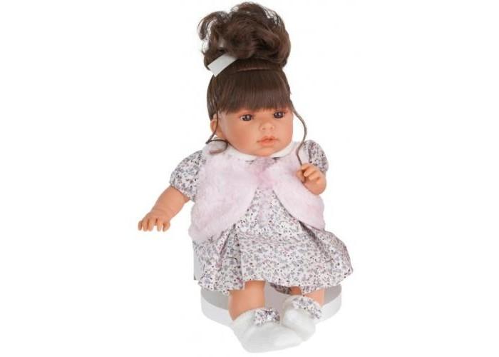 Munecas Antonio Juan  Кукла Лучия озвученная 37 смКукла Лучия озвученная 37 смКукла-младенец Лучия выглядит совсем как ребенок. Куклы одеты в чудесные наряды, созданные испанским дизайнером.   Личико сделано с детальными прорисовками. Глазки обрамлены пушистыми ресничками, не закрываются.  Образы малышей Мунекас разработаны известными европейскими дизайнерами. Они натуралистичны, анатомически точны, с подвижными ручками и ножками, копируют настоящих младенцев.  Малыш умеет разговаривать: нажмите на животик 1 раз - кукла засмеется, 2-ой раз - кукла скажет мама, 3-ий раз - скажет папа.   Кукла с виниловыми подвижными ручками, ножками и головой, и мягконабивным туловищем.   Кукла упакована в красивую подарочную коробку.  Куклы Antonio Juan Munecas существуют уже более 40 лет и пользуется заслуженной популярностью в Европе. Куклы производятся исключительно в Испании, из высококачественных материалов, безвредных для ребенка. Образы кукол разрабатываются ведущими Европейскими дизайнерами, они высокохудожественны, натуралистичны (девочки/мальчики), одеты в красивую современную одежду, сшитую из натуральных тканей. Упакованы в стильные фирменные коробки.  В наш век технического прогресса классические куклы Антонио Хуан, с милыми добрыми детскими чертами не перестают пользоваться популярностью, а способность разговаривать, смеяться и плакать делает их вполне современными и интересными даже для самых «продвинутых» деток.<br>