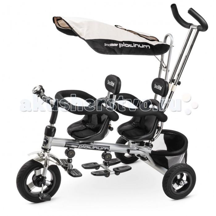 """Велосипед трехколесный Small Rider Platinum для двоих детейPlatinum для двоих детейВелосипед трехколесный Small Rider Platinum для двоих детей создан для тех, кто хочет, чтобы трехколесный велосипед выглядел не как пластиковая игрушка, а стильный, современный транспорт с максимумом удобств, функций и надежности.  Особенности: Можно перечислить его внешнее превосходства: благородный платиновый цвет, хромовая арка, изящность и строгость форм - данный велосипед проектировался с учетом всех детских потребностей и требований к внешнему виду трехколесного велосипеда супер-класса. Для максимального комфорта у велосипеда предусмотрены и два подголовника, и мягкая подложка на сиденьи, и большой солнцезащитный козырек, закрывающий полноценно две детские головы, и целых 3 складных подножки! Колеса поразят плавностью хода и проходимостью. Велосипед оснащен революционными резиновыми бескамерными покрышками, которые внешне выглядят как надувные, и всегда находятся в идеально накачанном состоянии (они не проколятся, их не нужно подкачивать, и велосипед всегда будет плавно катиться). Родительская ручка регулируется по высоте (телескопическая) может управлять направлением движения велосипеда и делать повороты руля за ребенка. Она сделана в виде штурвала, что очень удобно для родителей различного роста - и для мам, и для пап. Стальная рама и дизайн конструкции позволяют выдерживать вес двух детей суммарно вплоть до 35-40 кг. Что касается целевого диапазона, то велосипед """"Платинум"""" рассчитан на детей в возрасте от 1 года до 3-х лет. Что очень важно - у самого основания ручка трехколесного велосипеда Small Rider Platinum получила дополнительное усиление в виде дуги и двойной трубки для того, чтобы выдерживать запрыгивания на бордюры с двумя детьми на борту. редусмотрены и трехточечные ремни безопасности, и специальное защитное огорождение. Можно одновременно использовать и то, и другое.  Ремни безопасности с перемычкой посередине не дадут детям соскользнуть вниз, а за защитное огорожде"""