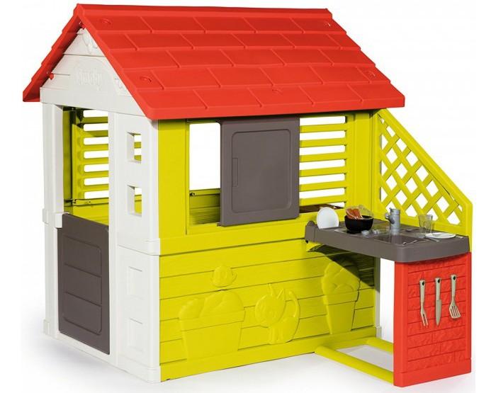 Smoby Игровой домик с кухнейИгровой домик с кухнейSmoby Игровой домик с кухней, 0.145 х 0.110 х 0.127 см - дети смогут играть на природе имея свой домик с летней кухней, где они могут приготовить себе еду на природе. Домик оснащен двумя окнами с открівающимися створками. Кухня состоит из пластины гриль и раковиніы.   В комплект входит 17 аксесуаров:  2 сосиски 2 стаканчика 2 тарелочки 2 вилки 2 ножика столовых ножик кухонный 2 чайные ложочки вилка  лопатка кастрюлька.<br>