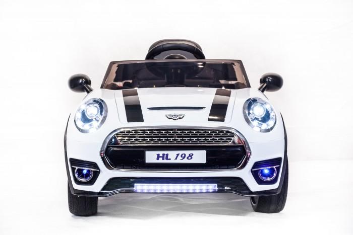 Электромобиль Toyland HL198HL198Электромобиль Toyland HL198 для ребенка от 1 года до 8 лет развивает скорость до 7 км/ч. Открывающиеся двери, огни фар и фонарей, а так же возможность включить свою музыку или радио делают этот электромобиль похожим на такой же, как у взрослых.  Ваше внимание сразу привлечет наличие панели приборов с подсветкой и автомагнитола. На руле имеются кнопки, отвечающие за регулировку громкости данной музыкальной системы, и клаксон. Также вы сможете переключать любимые треки простым нажатием на соответствующую кнопку. Установленная музыкальная система поддерживает карту памяти, также у нее имеется USB-выход, AUX и радиоприемник.  Автомобиль может достичь скорости равной 7 км/ч. Это возможно благодаря мощному аккумулятору 12V/7Ah и двум двигателям по 35W. У модели тщательно проработан вопрос светового оформления. Светодиодные фары машины светятся, как у настоящей. Также имеются габариты и задние фонари.  Всего у автомобиля 3 скорости, из которых: две вперед и одна назад. Их переключение осуществляется с помощью пульта ДУ, а для плавного набора скорости просто равномерно нажимайте на педаль газа. Радиус действия пульта дистанционного управления составляет 30 м, работает по Bluetooth.<br>