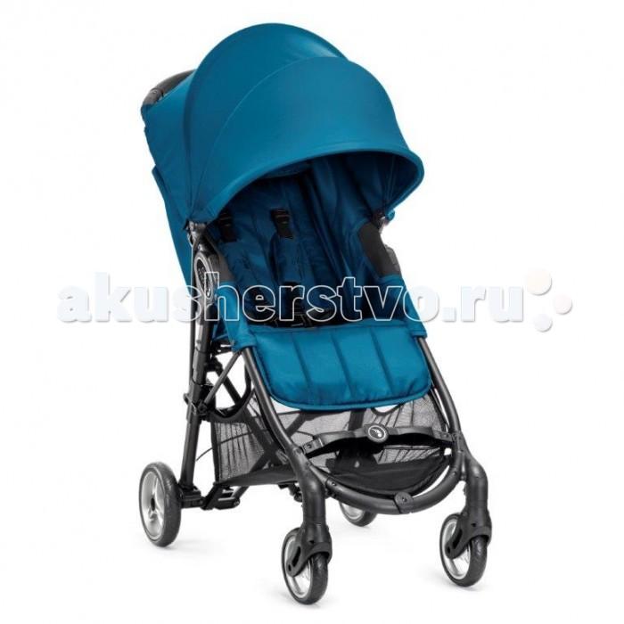 """Прогулочная коляска Baby Jogger City Mini ZipCity Mini ZipДетская облегченная коляска американской фирмы Baby Jogger City Mini Zip завоевала популярность во всем мире и предназначена для жителей мегаполисов, расставляющих следующие приоритеты при выборе колясок: высокое качество, маленький вес + удобное складывание.  Mini Zip обладает запатентованной технологией """"Quickfold"""" (легкое складывание) – так легко не складывается ни одна коляска! Просто потяните за ручку, не прикладывая усилия. Благодаря уникальной системе подвески передних колес, МС легко преодолевает пересеченную местность, несмотря на небольшие колеса.  Прогулочный блок: для детей возрастом от 0 до 3 лет (для новорожденных используется с люлькой-вкладышем) и весом до 25 кг мягко простеганная и одновременно плотная комфортная спинка сидения опускается в лежачее положение спинка с жесткой вставкой для дополнительной поддержки регулируемая подножка сзади коляска вентилируется в лежачем положении, а в плохую погоду при необходимости. вы сможете закрыть коляску при помощи вшитой сзади непродуваемой защитной шторки  просторное сидение эргономичной анатомической формы пятиточечные ремни безопасности с мягкими накладками большой капюшон с регулировкой складывания в несколько положений запатентованный тип универсального крепления различных аксессуаров на выбор, монтажный кронштейн  большой сетчатый карман для детских принадлежностей за спинкой сидения и большой багажный отсек под сиденьем - вместительная корзина с легким доступом к ней, даже когда ребенок спит в коляске, и спинка опущена ремень для мгновенного складывания и удобной переноски коляски встроен в сидении, резко потяните одной рукой за этот ремень, и коляска мгновенно и очень компактно сложится для транспортировки или хранения вся обшивка отстегивается для стирки   Шасси: полукруглая ручка удобной эргономичной формы 2 передних пируэтных колеса для точного маневрирования можно заблокировать при необходимости передвижения по рыхлой поверхности: песок, п"""