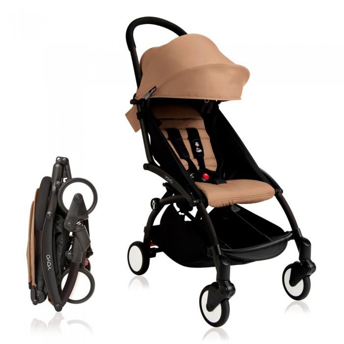Прогулочная коляска Babyzen Yoyo PlusYoyo PlusПрогулочная коляска Babyzen Yoyo Plus. Компактная прогулочная коляска полностью соответствует нормам и параметрам ручной клади для авиаперелетов. Она с легкостью помещается в верхний багажный отсек салона самолета.  Коляска YoYo+ предназначена для детей от полугода до четырех лет (18 кг), обладает массой преимуществ перед моделями той же весовой категории (5,5 кг).   У колясок 2016 года выпуска есть ряд отличий: возможность с помощью специальных адаптеров появилась установить на шасси коляски автокресла BeSafe iZi Go и iZi Go Modular, B&#233;b&#233; Confort Pebble и Pebble Plus, Cybex Aton Q, Maxi-Cosi Pebble и Pebble Plus; качество тканей стало еще лучше; корзина для покупок стала намного больше; максимальная рекомендуемая нагрузка на шасси выросла с 15 до 18 кг; появился кармашек для полезных мелочей на молнии в задней части капора; добавлена мягкая накладка на ремень для переноски коляски на плече; увеличена подставка для ножек.  Сиденье коляски Место малыша довольно просторное (ширина 32 см, глубина 25 см, высота спинки 45 см), с мягким цветным вкладышем. Спинка BabyZen YoYo+ многопозиционная, плавно регулируется ремешком. Раскладывается до угла наклона в 165 градусов. Капюшон коляски достаточно объемный, с дополнительным козырьком. В капюшоне есть силиконовое смотровое окошко. На задней шторке расположен кармашек для полезных мелочей на молнии.  Шасси коляски YoYo+ Каркас выполнен из ударопрочного, армированного стекловолокном материала DuPont Zytel. В сложенном виде коляска BabyZen YoYo+ занимает в два раза меньше места, чем классическая коляска-трость. Вращающиеся на 360° передние колеса диаметром 13 см автоматически фиксируются при езде по неровной дороге, обеспечивая легкий плавный ход. Эта уникальная система блокировки «Soft-Drive» запатентована компанией BabyZen. Также имеется небольшая педаль тормоза, которая не портит обувь, т.к. нет необходимости поддевать её снизу.  Ручка сплошная, поэтому коляска легко уп