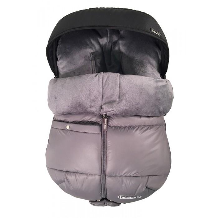 Зимний конверт Bebe Due для колясок и переносокЗимние конверты<br>Конверт Bebe Due - то мягкий и удобный шерстяной конверт, которая защитит малыша от непогоды и обеспечит ему дополнительное тепло и комфорт.  Используется для сезонной носки, можно использовать также в переноске.  ОСОБЕННОСТИ: Большое переднее и боковое отверстие молнии Материал: шерсть, полиэстер с элементами металла и пластика Предназначено для детей до 13 кг Анатомическая форма ХАРАКТЕРИСТИКИ: Страна изготовления: Китай (по лицензии компании Bebe Due (Испания)) Материал: полиэстер, шерсть Длина: 68 см Ширина: 46 см Высота: 37 см Утеплитель: шерсть Подкладка: шерсть Наружный материал: полиэстер Прорези для ремней безопасности: есть Сезон: весна,осень,зима