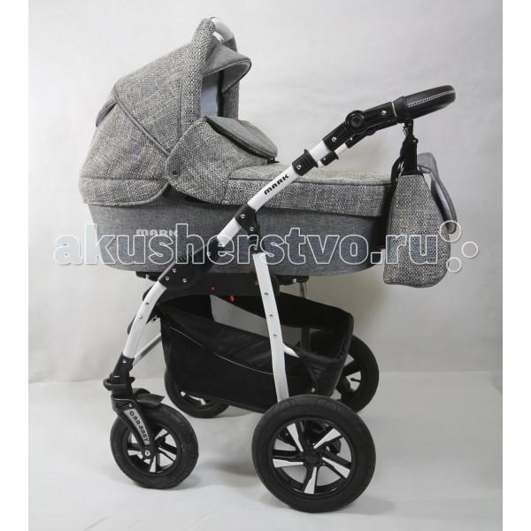 Коляска Car-Baby Mark Ecco 3 в 1Mark Ecco 3 в 1Коляска Car Baby Mark Ecco Koc - это современная многофункциональная коляска 3 в 1 с дополнительной амортизацией и полным набором всех необходимых регулировок и функций для комфортных прогулок в любое время года!   Высокая проходимость за городом + улучшенная маневренность в городе. Внешняя износостойкая обивка в классическом стиле, установка каждого модуля на шасси менее, чем за 1 минуту.  Шасси: надувные колеса пара передних колес — «движение только прямо» или «поворот на 360 &#186;» задние большие колеса ручка управления с высококачественной обшивкой из эко-кожи сложение по типу книжки очень вместительная багажная корзина.  Люлька: капюшон с объемным козырьком и ручкой для переноски окно для наблюдения закрывается тканевым клапаном возможность открыть в капюшоне отсек для проветривания экологичная внутренняя обшивка и матрасик высокий ветронепродуваемый борт полностью закрывает ребенка от непогоды. размер: 83 х 39 см  Прогулочное сиденье: установка лицом «от себя» или «к себе» регулировка наклона спинки одной рукой опора для ног имеет несколько позиций бампер с разделителем ножек страховочные пятиточечные ремешки с тканевыми накладками по всей длине многопозиционный капюшон.  Автокресло: группа 0 +, для детей с рождения до годовалого возраста допустимая масса тела младенца — до 13 кг эластичный капор мягкий вкладыш с системой страховочных ремешков накидка из плотного материала на ножки.  Внутренний размер люльки (ДхШхГ) : 78х35х23 см.<br>