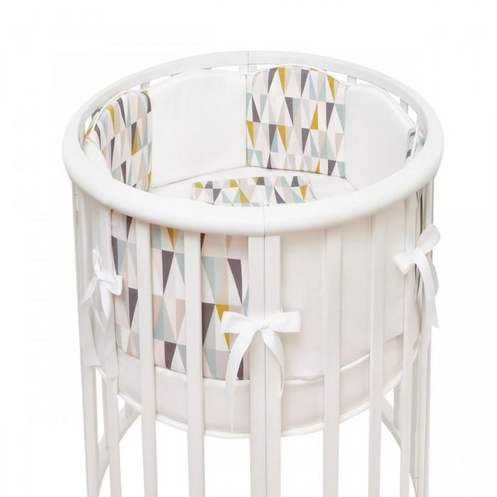 Комплект в кроватку Colibri&Lilly Puzzle Round (5 предметов)Комплекты в кроватку<br>Комплекты в кроватку ColibriLilly Puzzle Round (5 предметов) весь текстиль быстро и удобно снимается, постельные принадлежности выдерживают большое количество стирок, что так важно для современных мам и их малышей.  Хлопок абсолютно гипоаллергенен и безопасен для малыша и позволяет нежной коже дышать, прекрасно впитывая влагу.  Состав комплекта: Защитные бортики – «вафли»  по всей окружности круглой кроватки 75 х 75 см и овальной кроватки  125 х 75 см (принт коллекции). Бортик состоит из 4-х частей - 2 части по 8 вафель и 2 части по 4 вафли. Высота бортиков - 25 см. Пододеяльник (принт коллекции) 132 х 102 см Наволочка (принт коллекции) 62 х 32 см Простыня на резинке для круглой кроватки 75 х 75 см (однотонная)  Простыня на резинке для овальной кроватки 125 х 75 см (однотонная)