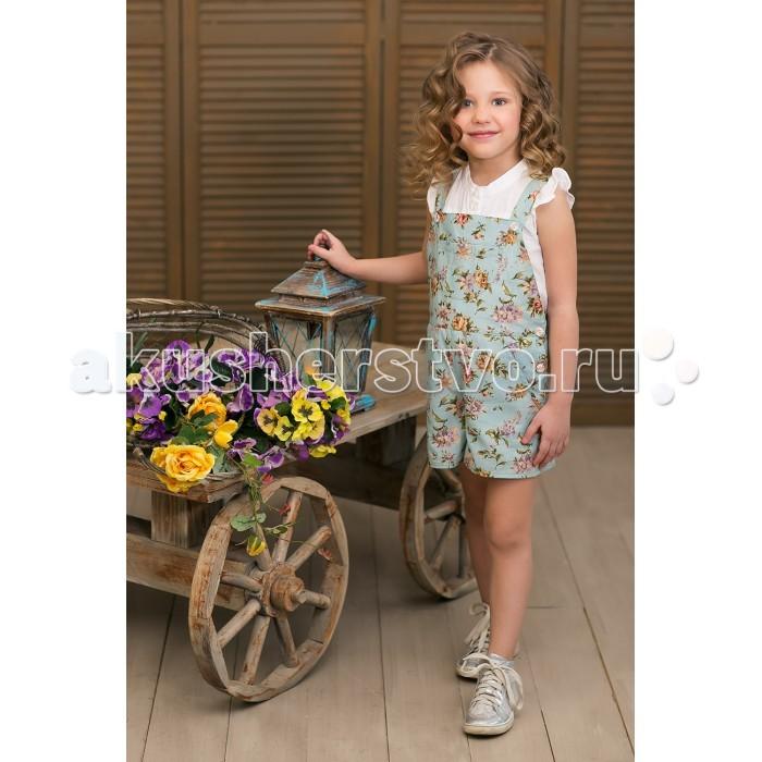 Frizzzy Комбинезон для девочки Цветы на голубомКомбинезон для девочки Цветы на голубомFrizzzy Комбинезон для девочки Цветы на голубом из натуральных материалов. 100% хлопок.   Малышке будет очень комфортно в этом комбинезоне, ведь хлопок практически не нагревается и гигроскопичен (он впитывает влагу и при этом остается сухим).   На ощупь хлопок - мягкий. Малышке будет очень приятно носить платье. Модный и современный дизайн будет радовать глаз. Прочность, комфортность, натуральность ткани будут радовать родителей.<br>
