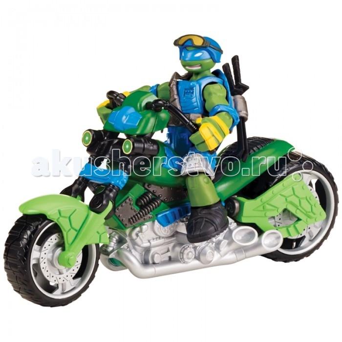 Turtles Игровой набор Мотоцикл-квадрокоптер с фигуркой ЛеоИгровой набор Мотоцикл-квадрокоптер с фигуркой ЛеоTurtles Игровой набор Мотоцикл-квадрокоптер с фигуркой Лео   Особенности: Квадрокоптер - трансформер с фигуркой Леонардо серия Mutatoin. Любимый герой мальчишек из культового мультфильма. Леонардо обожает скорость! Его мотоцикл легко траснформируется в летательный аппарат, это позволяет Лео быть непобедимым. Черепашка - мутант имеет полное боевое снаряжение. Игрушка выполнена из высококачественного пластика ярких цветов. Голова, руки и ноги подвижны, что создает максимальную реалистичность игрушки.  Высота фигурки: 12 см. Длина мотоцикла: 20 см<br>