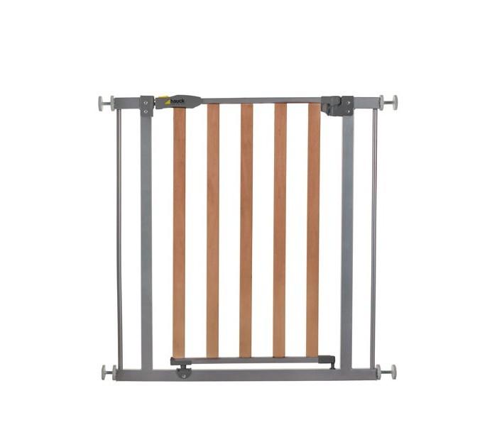 Hauck Детские ворота Metal Wood DeluxeБарьеры и ворота<br>Детские ворота Hauck Metal Wood изготовлены из дерева и стали с порошковым покрытием. Обеспечат максимальную безопасность для ребенка. Монтаж ворот производится быстро и легко, нет необходимости в сверлении, подходит для дверного проема от 75 до 81 см.  Ворота безопасности Hauck оснащены двойным запорным механизмом. Можно настроить открывание ворот в одну сторону, в другую сторону устанавливается стопор. Все ворота безопасности от Hauck сертифицированы и безопасны для применения. Благодаря специальному расширителю (продается отдельно), эти ворота можно устанавливать в дверной проем от 84 до 123 см.  Возможные вариации расширения: с расширителем: 9 см = ширина от 84 до 90 см с расширителем 9 см + 9 см = ширина от 93 до 99 см с расширителем 21 см = ширина от 96 до 102 см с расширителем 21 см + 21 см = ширина от 117 до 123 см с расширителем: 9 см + 21 см = ширина от 105 до 111 см  Особенности: Легко регулируется с помощью винтов Механизм блокировки для двойной безопасности Может открываться с двух сторон Опциональное расширение до 123 см Качественная деревянно-металическая конструкция