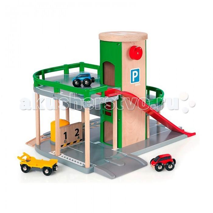 Brio Парковка к Ж/Д полотну с лифтом и 3 машинкамиПарковка к Ж/Д полотну с лифтом и 3 машинкамиBrio Парковка к Ж/Д полотну с лифтом и 3 машинками. Парковка для машинок позволяет соединить вместе мир железных и автомобильных дорог воедино и построить целый движущийся город, а, может быть, и целую страну.   Парковка оснащена лифтом, который поднимает машинки с первого уровня на второй, и спуском, чтобы позволить машинкам с легкостью съезжать вниз. Поместите машинку на второй уровень на рампу, нажмите на кнопку, и вы увидите, как она грузится на вагончик-эвакуатор внизу. Первый уровень снабжен соединительной деталью для продолжения железнодорожного полотна.   В набор входят 2 машинки и вагончик-эвакуатор.<br>