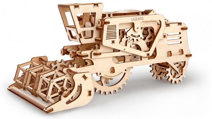 Конструктор Ugears 3D-Пазл Комбайн 154 детали3D-Пазл Комбайн 154 деталиКонструктор 3D-Пазл Ugears Комбайн - это механический 3D-пазл, который собирается в самоходную модель на резиновом приводе.  Модель вдохновлен зерноуборочным комбайном. Как и у прототипа, у нее есть молотильный барабан для срезания колосьев, который вращается, когда модель едет. На крыше комбайна находится потайное отделение. В нем можно перевозить мелкие вещи и передавать записки, отправляя модель ездить по комнате.  Дизайн Модель выполнена в узнаваемом стиле UGears, в котором корпус максимально открывает внутренний механизм для любования. Колеса выполнены в виде шестерней, молотильный барабан аналогичен оригинальному (только вместо лезвий – зубочистки).  Набор изготовлен из фанеры при помощи программируемого лазерного станка: детали легко выдавливаются из планшетов, заусенцев практически не образуется, все надписи (режимы движения, условные обозначения, логотип производителя) нанесены тоже при помощи лазера. По качеству эти модели намного превосходят изготовленные штампованием.  Как это работает? Рычаг на левом борту открывает створки потайного отделения, на правом – может заблокировать или запустить двигатель. С началом движения колеса передают крутящий момент на барабан, и он начинает вращаться. Механизм работает как с резиномотором, так и без него.  Конструктор собирается без клея и дополнительных инструментов. Для смазки вращающихся деталей можно использовать стеариновые и восковые свечи.  Характеристики Материал фанера (ФК) Размеры упаковки 370 &#215; 170 &#215; 30 мм Размеры модели 135 &#215; 165 &#215; 278 мм   Что в коробке Набор планшетов с деталями для сборки 3D-пазла Комбайн Документация (RU, UA, EN)<br>