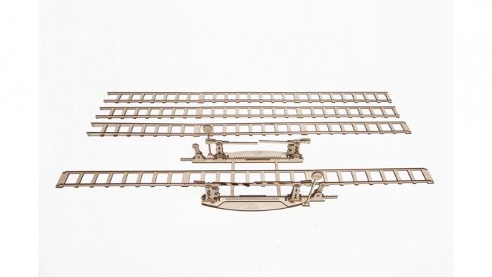 Конструктор Ugears 3D-Пазл Переезд 200 деталей3D-Пазл Переезд 200 деталейКонструктор 3D-Пазл Ugears Переезд  Там, где есть железная дорога, есть и железнодорожный переезд. Вы получите 4 метра железной дороги в комплекте с переездом и работающими шлагбаумами, которые поднимаются и опускаются нажатием рычага. Модель собирается самостоятельно без клея.  Дизайн Переезд UGears отлично дополняется моделями «Поезд» и «Перрон», позволяя вам иметь собственную железнодорожную станцию прямо на своем рабочем столе, а стильный и оригинальный дизайн модели приведет в восторг инженеров-любителей любого возраста. В модели присутствует выдвижной ящик, открываемый замком и ключом.  Как это работает? Для сборки модели вам не потребуются клей или дополнительные инструменты. Просто выдавите детали из планшетов, запаситесь зубочистками и терпением. Подвижные сочленения можно смазать восковой или стеариновой свечой.   Характеристики Размер модели 4070 х 120 х 225 мм Размер упаковки 370 х 170 х 30 мм Количество деталей 200 Материал  Фанера (ФК)   Что в коробке 3D-пазл UGears Переезд (Rails) Документация (RU, UA, EN)<br>