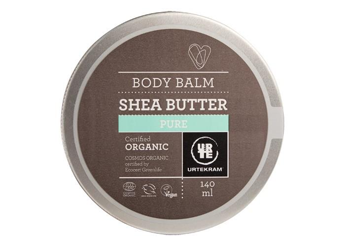 Urtekram Бальзам для тела с маслом Ши 140 млБальзам для тела с маслом Ши 140 млБальзам для тела с маслом Ши 140 мл - органический интенсивный питательный и увлажняющий бальзам для тела, лица, ногтей и волос с маслом ши. Его можно использовать в качестве ночной маски и даже для секущихся кончиков волос. Масло Ши известно своими питательными, успокаивающими и регенерирующими свойствами. Это естественный УФ-фильтр, увлажнение, устранение раздражения, а так же повышение тонуса и упругости кожи. Незаменим в зимний период.    Сертифицировано ECOCERT Greenlife в соответствии с COSMOS ORGANIC.  100% натуральных компонентов.<br>