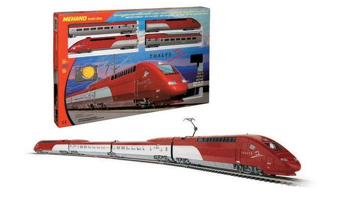 Mehano Железная дорога ThalysЖелезная дорога ThalysЖелезная дорога «MEHANO» Thalys - отличная модель скоростного состава. Обтекаемые линии, темно-алый цвет, быстрое движение поезда делают его похожим на механическую птицу, которая летит по рельсам, будто не касаясь их.   Это стремительное изящество вписано в рамки рельсового овала, но при желании железнодорожное полотно можно увеличить, ведь все элементы железных дорог «MEHANO» совместимы друг с другом. Рельсы металлические, колеса паровозов из металла, Очень качественная игрушка.   Характеристики железной дороги «MEHANO» Thalys:  • масштаб 1:87;  • работает от электрической сети через адаптер – 220 вольт;  • возможность изменения скорости движения;  • размер собранного железнодорожного полотна: 117,5  смх 95,5 см;  • ширина колеи: 16,5 мм;  • размер упаковки: 64 x 38,5 x 34,5 см;  • все элементы комплекта совместимы с другими сборными моделями железной дороги «MEHANO», так что юный машинист сможет прокладывать различные маршруты, строить новые станции и придумывать неповторимый, свой собственный уникальный ландшафт.   В комплекте:  • 1 ведущий локомотив Thalys, 1 ведомый локомотив Thalys, 1 вагон первого класса, 1 вагон второго класса;  • 3,35 метров железнодорожного полотна: 12 радиальных рельс, 2 прямых;  • сетевой адаптер;  • пульт-контроллер;  • подробная инструкциями по сборке и управлению (с иллюстрациями).<br>