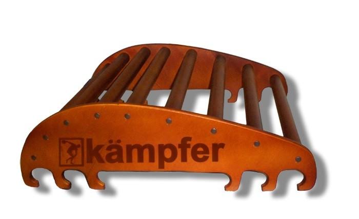 Kampfer Домашний спортивный тренажер Posture 1 WallДомашний спортивный тренажер Posture 1 WallKampfer Домашний спортивный тренажер Posture 1 Wall для улучшения осанки.  Правильная осанка - сделает Ваше тело красивым, формы фигуры приобретут гармонию походка станет привлекательной, обретет легкость и грациозность - достойные восхищения.  Особенности: Конструкция из натурального дерева, используется итальянское покрытие Coatings Italia S.p.a. Места креплений болтов закрыты декоративными пластиковыми заглушками Рекомендован для установки в домашних условиях и в детских учреждениях. Компактная разборная конструкция, которая позволяет перевозить его даже в легковом автомобиле. Тренажерный комплекс Kampfer Posture предназначен для занятий физическими упражнениями, позволяющими расслаблять, разминать и массировать мышцы спины в домашних условиях. Предназначен для улучшения осанки, поэтому в первую очередь необходимо привлечь к занятиям подростков, и даже маленьких детей. Им неприменно понравиться занятия на тренажере под Вашим руководством и присмотром. Подходит для детей в возрасте от 4 лет и рекомендован для установки в домашних условиях и в детских учреждениях. Конструкция была выполнена из натурального дерева, все края деталей немного скруглены, места креплений болтов закрыты декоративными пластиковыми заглушками обеспечивая большую безопасность для ребенка. Крепление: может устанавливаться на любую ровную поверхность пола. Устойчивость тренажера обеспечивает строение конструкции, а относительно небольшие вес и размеры позволяют с легкостью передвигать тренажер с места на место, и убирать на хранение.  Тренажер для спины(Дл. х Шир. Выс.): 64 х 54 х 20 см Длина ступеньки-перекладины: 51 см Диаметр ступеньки-перекладины: 3,5 см Допустимая нагрузка: 100 кг<br>