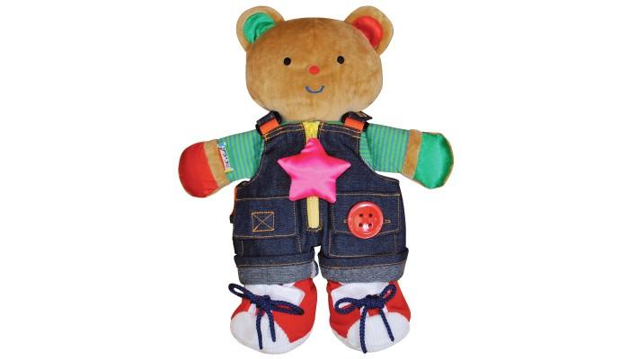 Мягкая игрушка KS Kids Медвежонок TeddyМедвежонок TeddyМедвежонок Teddy в одежде Ks Kids поможет ребенку научиться навыкам одевания с помощью различных застежек.  Симпатичный медвежонок Teddy в джинсовом комбинезоне и красных кедах подарит своему обладателю мгновения мягких объятий и приятных воспоминаний.   В комплект с медвежонком входит рюкзак с запасной кофточкой. Изготовлен из мягкого приятного на ощупь материала.   Мягкая игрушка может стать милым подарком, а может быть и лучшим другом на все времена.<br>