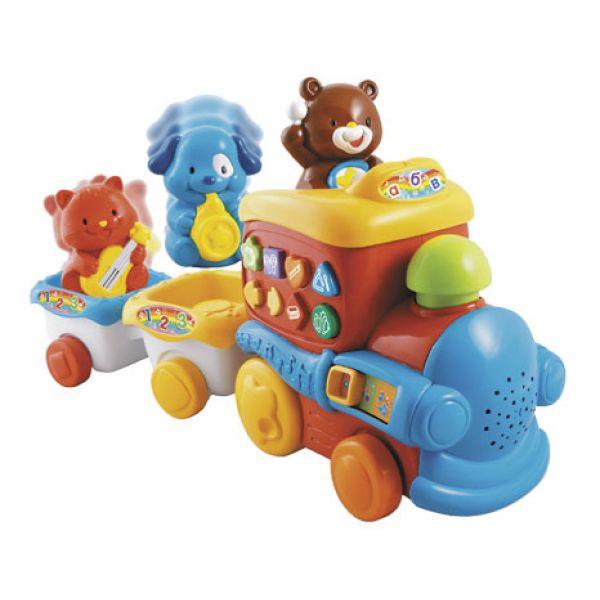 Vtech Музыкальный поезд 80-112726Музыкальный поезд 80-112726Игрушка развивающая Vtech Музыкальный поезд станет прекрасным подарком для познавательного ребенка. Он выполнен в ярких красочных тонах, поэтому обязательно понравится малышу. А разнообразие полезных и интересных функций надолго привлечет внимание непоседы.  Поезд с двумя вагончиками можно катать как настоящий, в паровозике и в вагончиках сидят зверушки, которые двигаются под музыку; их также можно снять с платформ, чтобы играть отдельно.   С этим замечательным поездом малыш сможет выучить геометрические фигуры, научится различать животных и музыкальные инструменты, ну и, конечно же, послушать музыку - музыкальный поезд проигрывает 2 песенки из мультфильма.   Игрушка Музыкальный поезд имеет 2 режима игры, она поможет малышу развить мышцы рук и мелкую моторику, а также поможет малышу перейти от ползанья к хождению.<br>