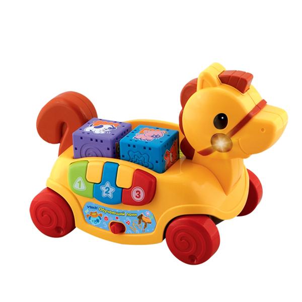 Каталка-игрушка Vtech Обучающая пони  80-111126Обучающая пони  80-111126Развивающая игрушка Vtech Обучающая пони подходит малышам от 6 месяцев .  Игрушка в виде маленького пони на колесиках , не оставит равнодушным вашего малыша.  Малыш может толкать игрушку, или тянуть за веревочку.  На боку пони есть клавиши, имитирующие клавиши пианино с цифрами. Клавиши трех цветов - красный, синий и зеленый. В спинке лошадки - пазы для больших кубиков с объемными рисунками для развития тактильного восприятия. Кубики можно вынимать и вставлять обратно.  Игрушка озвучена: проигрывает веселые мелодии и говорит несколько фраз.  Особенности игрушки:  2 режима игры игрушку можно катать учим цвета пианино светящиеся кнопки профессиональная одноголосая русская озвучка кнопка включения и выключения режимов<br>