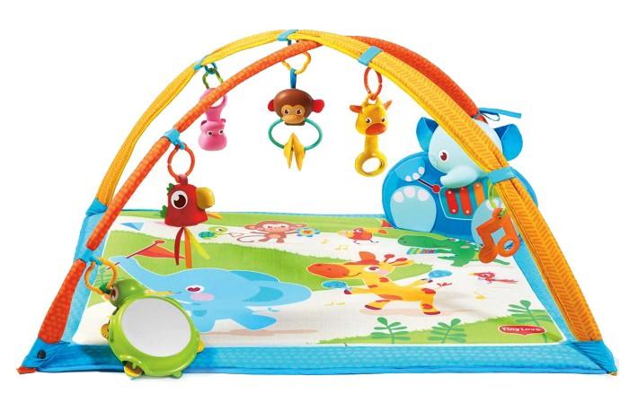 Развивающий коврик Tiny Love Мои музыкальные друзья (звук)Мои музыкальные друзья (звук)Развивающий коврик Мои музыкальные друзья от израильского бренда Tiny Love - это товар, который будет очень полезен и интересен самым маленьким детям. Комплект состоит из мягкого коврика, двух арок, на которые вешаются погремушки и прорезыватели и музыкального слона. Малышу будет очень интересно играть с игрушками-подвесками, которые имеют яркий дизайн. На самом коврике тоже изображена интересная и красочная картина с тропическими животными. Слон Kicker - это игрушка, которая будет воспроизводить различные звуки и мелодии, когда ребенок будет на него нажимать ногой. Работает он от обычных мизинчиковых батареек.  Мои музыкальные друзья поможет ребенку развить логику, мелкую моторику рук и контакт с окружающей средой. Такая игрушка принесет много пользы и радости малышу.  В комплекте:   Коврик; Дуги; Слон Kicker; Погремушки; Прорезыватели; Черепаха-зеркальце.  Особенности:   Размер упаковки: 78 x 59 x 7,8 см Размер коврика: 88 х 80 х 45 см Вес: 1.45 кг<br>