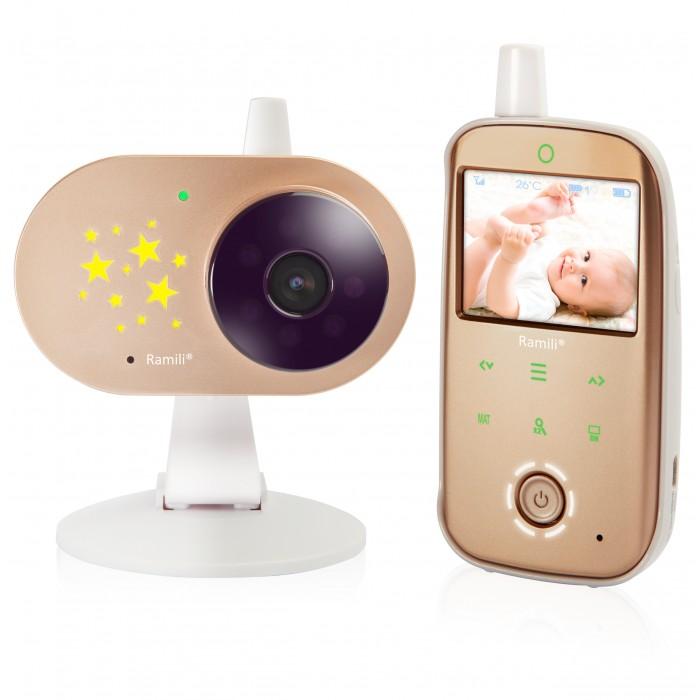 Ramili Видеоняня Baby RV1200Видеоняня Baby RV1200Ramili Видеоняня Baby RV1200 к которой можно подключить монитор дыхания Ramili Sensor Pad. Видеоняня оснащена всеми необходимыми функциями для комфортного удалённого наблюдения за ребёнком.  Особенности: Диагональ дисплея видеоняни составляет 6,1 см (2,4 дюйма).  Оптимальная величина дисплея значительно увеличивает время работы видеоняни без подзарядки.  Дальность приёма составляет 300 метров. Используется современная цифровая технология передачи данных, поэтому связь между блоками стабильна и отличается высоким качеством. Благодаря этому обстоятельству существенно повышается безопасность и надёжность мониторинга. Особенно удобно использовать видеоняню Ramili Baby RV1200 во время прогулок или в загородном доме. Лёгкую и компактную камеру, оснащённую специальным механизмом складывания, возможно закрепить на козырьке коляски, на бортике манежа или кроватки. Камера оснащена встроенным аккумулятором, благодаря чему видеоняня отлично работает на улице, на балконе и в условиях отсутствия постоянного источника питания.  Автоматическое ночное видение. Ночник со звёздочками на детском блоке. Стабильная, защищённая цифровая связь. Качественное изображение и звук. Система подавления помех связи. Аккумулятор в родительском и детском блоках. Индикаторы уровня заряда каждого блока отображаются на экране. Оповещение о низком заряде. Динамическая система сохранения энергии (мощность передачи регулируется автоматически, зависит от расстояния между блоками). Оповещение о выходе их зоны приёма. Специальная конструкция крепления камеры для удобного размещения на бортике кроватки или манежа, а также на козырьке детской коляски. Двухсторонняя связь. Термометр в детском блоке для измерения температуры воздуха в детской. Значение отображается на экране родительского блока. Оповещение о выходе температуры за пределы заданного диапазона. Индикатор громкости плача (удобно при выключенном звуке). Возможность подключения до 4-х камер. Система акт