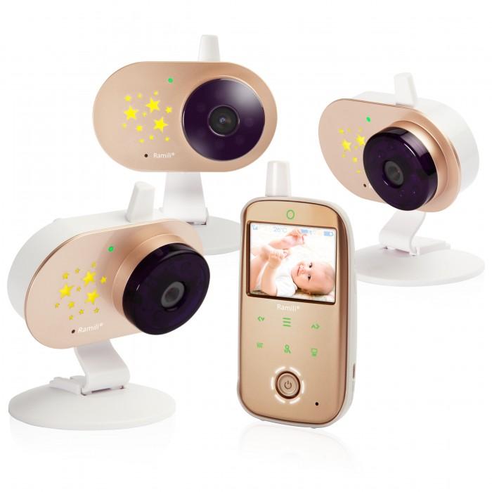 Ramili Видеоняня Baby RV1200X3Видеоняня Baby RV1200X3Ramili Видеоняня Baby RV1200X3 с тремя камерами оснащена всеми необходимыми функциями для комфортного удалённого наблюдения за ребёнком.  Особенности: Диагональ дисплея видеоняни составляет 6,1 см (2,4 дюйма). Оптимальная величина дисплея значительно увеличивает время работы видеоняни без подзарядки.  Дальность приёма составляет 300 метров. Используется современная цифровая технология передачи данных, поэтому связь между блоками стабильна и отличается высоким качеством. Благодаря этому обстоятельству существенно повышается безопасность и надёжность мониторинга. Особенно удобно использовать видеоняню Ramili Baby RV1200 во время прогулок или в загородном доме. Лёгкую и компактную камеру, оснащённую специальным механизмом складывания, возможно закрепить на козырьке коляски, на бортике манежа или кроватки. Камера оснащена встроенным аккумулятором, благодаря чему видеоняня отлично работает на улице, на балконе и в условиях отсутствия постоянного источника питания.  Автоматическое ночное видение. Ночник со звёздочками на детском блоке. Стабильная, защищённая цифровая связь. Качественное изображение и звук. Система подавления помех связи. Аккумулятор в родительском и детском блоках. Индикаторы уровня заряда каждого блока отображаются на экране. Оповещение о низком заряде. Динамическая система сохранения энергии (мощность передачи регулируется автоматически, зависит от расстояния между блоками). Оповещение о выходе их зоны приёма. Специальная конструкция крепления камеры для удобного размещения на бортике кроватки или манежа, а также на козырьке детской коляски. Двухсторонняя связь. Термометр в детском блоке для измерения температуры воздуха в детской. Значение отображается на экране родительского блока. Оповещение о выходе температуры за пределы заданного диапазона. Индикатор громкости плача (удобно при выключенном звуке). Возможность подключения до 4-х камер. Система активации видеоняни при обнаружении плача (VOX). Непр