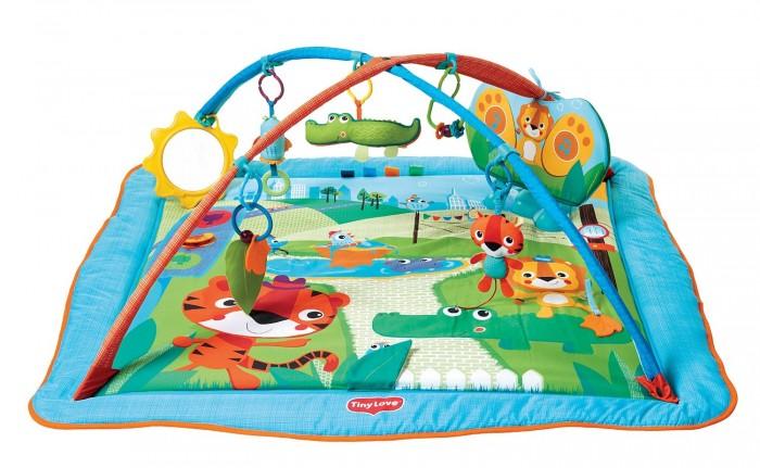 Развивающий коврик Tiny Love СафариСафариРазвивающий коврик Tiny Love Сафари - яркий, нежный и безопасный коврик c бортиками, игровой музыкальной панелью, множеством игрушек. Малыш будет получать массу положительных эмоций с самого рождения.  В комплекте: 5 подвесных игрушек безопасное зеркало интерактивная музыкальная панель скользящие кольца позволяют менять расположение игрушек и разнообразить игру открывающие мягкие борта, увеличивающие размер коврика  Размер коврика: 100х110х45 см.<br>