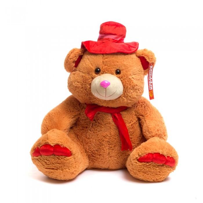 Мягкая игрушка Нижегородская игрушка Мишка в шляпе большой 90 смМишка в шляпе большой 90 смМишка  в яркой шляпе и шарфом на шее непременно станет настоящим любимцем.   Веселый пушистый медвежонок с мягким толстым тельцем и подвижными лапами изготовлен из высококачественного, гипоаллергенного искусственного меха и синтетического наполнителя, которые безопасны для здоровья ребенка.   Очаровательный мягкий мишка выглядит очень забавно и непременно поднимет настроение даже в самый грустный день. Его приятно держать в руках.  Играя с ним у ребенка формируются новые навыки, развиваются тактильные ощущения и фантазия.<br>