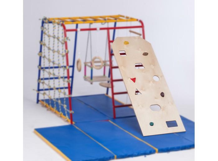 SportsWill Скалодром для Спортивного комплекса Baby HitСкалодром для Спортивного комплекса Baby HitSportsWill Скалодром для Спортивного комплекса Baby Hit  Детский скалодром - весёлое, полезное и безопасное приключение в домашних условиях. Занятия на скалодроме - это полезная нагрузка для всех групп мышц, развитие гибкости и ловкости, умения контролировать свое тело.   Скалодром для спорткомплексов разработан таким образом, чтобы занятия ребенка были разнообразны каждый день: меняя положение спорткомплекса, вы переставляете скалодром - и вот уже перед вами новая конструкция!     При первом знакомстве обязательно покажите принцип лазания по скалодрому: одновременно ребенок должен касаться 3 точек (2 руки и нога, 2 ноги и рука). При перемещении необходимо отрывать от поверхности только одну опору – руку или ногу. Отверстия скалодрома выполнены в виде геометрических фигур: треугольника, квадрата, многоугольника,- а выступы – из разноцветной массы. Комментируйте движения ребенка словами: «Ставь ножку в треугольное отверстие, держись за зеленый выступ». Тем самым вы параллельно будете изучать геометрические фигуры и цвета.   Скалодром хорошо помогает в развитии умственной деятельности: именно разнонаправленные движения руками и ногами способствуют налаживанию связей между различными разделами головного мозга!   Материал: Дерево Размер: 140 х 55 см Максимальная нагрузка: 40 кг<br>