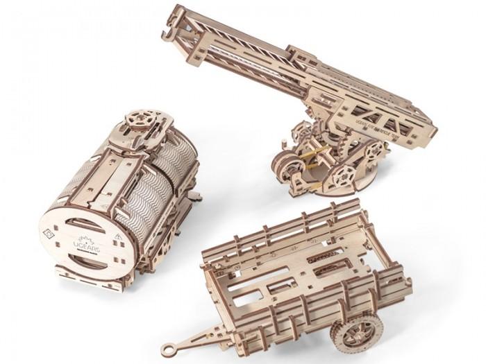 Конструктор Ugears 3D-пазл Дополнение к грузовику UGM-11 322 детали3D-пазл Дополнение к грузовику UGM-11 322 деталиUgears Конструктор 3D-пазл Дополнение к грузовику UGM-11 322 детали механический 3D-пазл, модель для самостоятельной сборки без клея и специальных инструментов - готовые детали просто вынимаются из доски. Соберите дополнительные варианты кузова и превратите ваш грузовик UGM-11 в автоцистерну, пожарную машину или грузовик с прицепом.   Особенности  Цистерна: Цистерна оснащена механизмом для открытия Позволяет поместить стандартную жестяную банку объемом 0.33 л Покрутите ручку на крышке цистерны и части конструкции откроются в стороны Пожарная лестница: Выдвижная 3-секционная пожарная лестница длиной в 70 см в разложенном виде Нажатием рычага вы можете поднять лестницу, вращать платформу вправо или влево или зафиксировать выбранное положение при помощи храпового механизма Все три секции лестницы выдвигаются вперед Поднимите лестницу и вы получите настоящий подъемный кран с крючком на краю лестницы На основу большой лестницы крепится дополнительная маленькая лестница для подъема наверх Прицеп: Рама с колесами, на которую крепится стандартный кузов для грузовика У прицепа есть реалистичные рессоры, на которых кузов прицепа покачивается во время езды Под дышлом есть специальная подпорка, чтобы модель могла стоять автономно.<br>