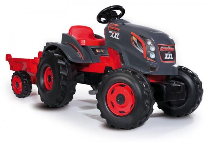 Smoby Трактор педальный XXL с прицепомТрактор педальный XXL с прицепомSmoby Трактор педальный XXL с прицепом, 0.160 х 0.059 х 0.056 см благодаря этому трактору, ваш ребенок больше времени будет  проводить на свежем воздухе. А также, будет стимулировать желание ребенка вам помочь  по господартсву. Ведь благодаря прочному и вместительному  прицепу, ваш малыш сможет перевезти песок, камни, или урожай с грядок.   Педали трактора при необходимости фиксируются, таким образом, транспорт более устойчивый и безопасный для малыша. Передние колеса поворотные, что делает трактор более маневренным.   Характеристики: Управление рулевое Приводится в движение педалями Цепной привод на заднее левое колесо Сидение регулируется Прицеп съёмный нагрузка до 25 кг веса Колёса пластмассовые, передние поворотные Капот не открывается.<br>