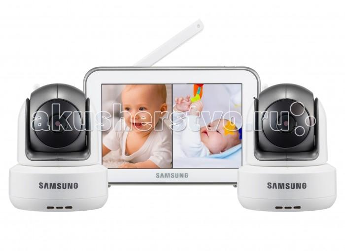 Samsung Видеоняня 2 камерыВидеоняня 2 камерыSamsung Видеоняня отличается высоким качеством и надёжностью. Благодаря наличию самых востребованных функций, видеоняня удобна в обращении и в значительной степени упрощает повседневную работу родителей. Качество изделия, которое характерно зарекомендовавшему себя производителю, обеспечивает высокую безопасность, высокое качество изображения и звука. Обеспечена гарантией производителя и надлежащим уровнем сервиса.   В комплекте видеоняни 2 камеры. Оснащена функцией разделения экрана для просмотра всех подключенных к системе детских блоков одновременно. Предусмотрен также и режим сканирования, в котором с промежутком в несколько секунд на экран выводится изображение с каждой камеры поочередно. Видеоняня оснащена всеми необходимыми современным родителям функциями и удобна в повседневном использовании. Современные технологии цифровой передачи данных, используемые в устройстве, обеспечивают качественную и устойчивую к помехам связь без интерференции.   Особенности: Изображение камеры высокого качества HD 720p (разрешение 1280 x 720, эффективные пиксели H: 1280 / V: 1024) Высокое качество изображения на мониторе, разрешение 800 х 480 пикселей Сенсорный дисплей, управление с помощью прикосновения к экрану Удалённое управление поворотом камеры с родительского блока Поворот камеры: 300o по горизонтали 110o по вертикали, чем обеспечивается полный обзор комнаты Угол обзора камеры в пассивном положении 55o (обычно этого достаточно, чтобы охватить больше половины детской комнаты, зависит от места расположения) Двухсторонняя связь позволяет успокоить кроху на расстоянии, если он расплакался Высокое качество звука Ночник на детском блоке, управляемый с родительского блока Чистый цифровой сигнал обеспечивает надёжную связь, которую не могут прервать работающие роутеры, микроволновая печь, домашний радиотелефон или прочие бытовые электронные приборы Режим ночного видения включается автоматически при недостаточном освещении Инфракрасная по