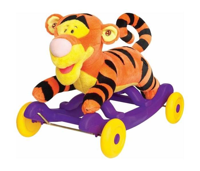 Каталка-игрушка Kiddieland Тигруля плюш каталкаТигруля плюш каталкаКаталка - качалка Тигруля в виде любимого тигренка из мультфильма выполнена в красивом стиле, сочетает в себе качества удобства и комфорта, так как сделана из плюша с мягкой набивкой.   Играть возможно двумя способами: кататься (при установленных колёсиках) и качаться на пластиковых полозьях (при снятых колёсиках).  У каталки удобное сиденье и колесики для катания ребенка. По необходимости у каталки легко снимаются колесики и она становится качалкой на дугах.  Ритмичные покачивания успокаивают малышей, а также способствуют развитию вестибулярного аппарата.  Игрушка предназначается для домашнего использования.   Максимальная нагрузка: 25 кг  Для работы нужны 3 батарейки АА (входят в комплект)  Размер: 36,5 х 61,5 х 43 см<br>